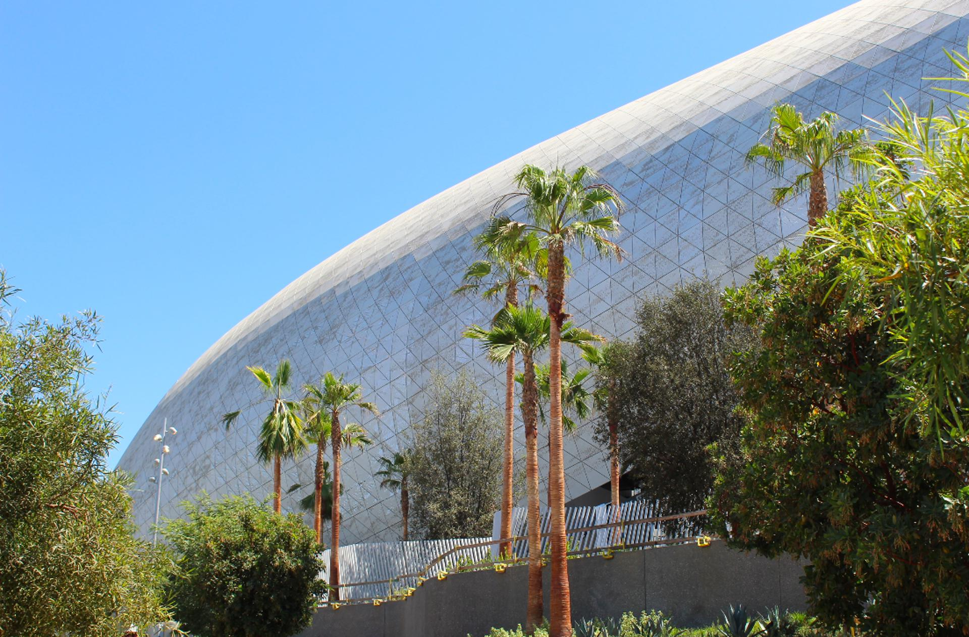 A daylight view of the perforated aluminum panel canopy and skin for SoFi Stadium.