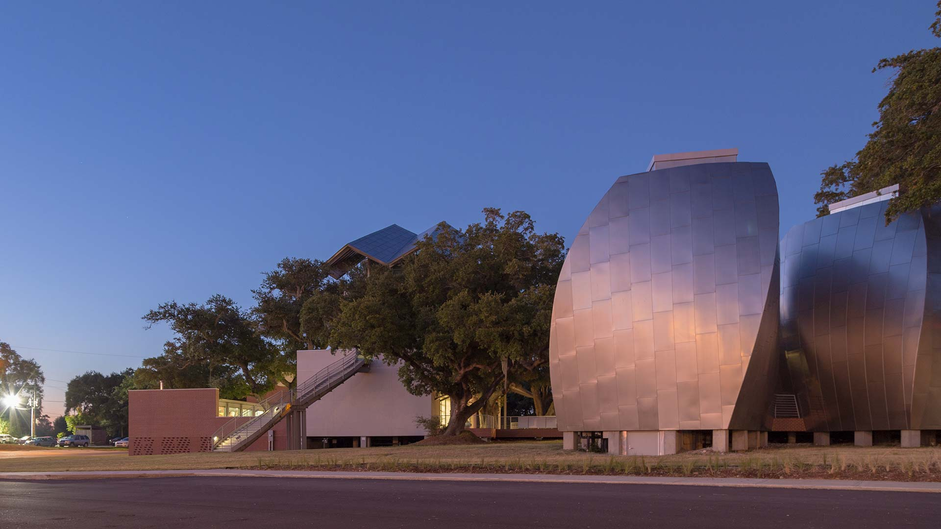 OHR O'KEEFE MUSEUM AT DUSK, FEATURING ANGEL HAIR STAINLESS STEEL AND ZEPPS TECHNOLOGY.