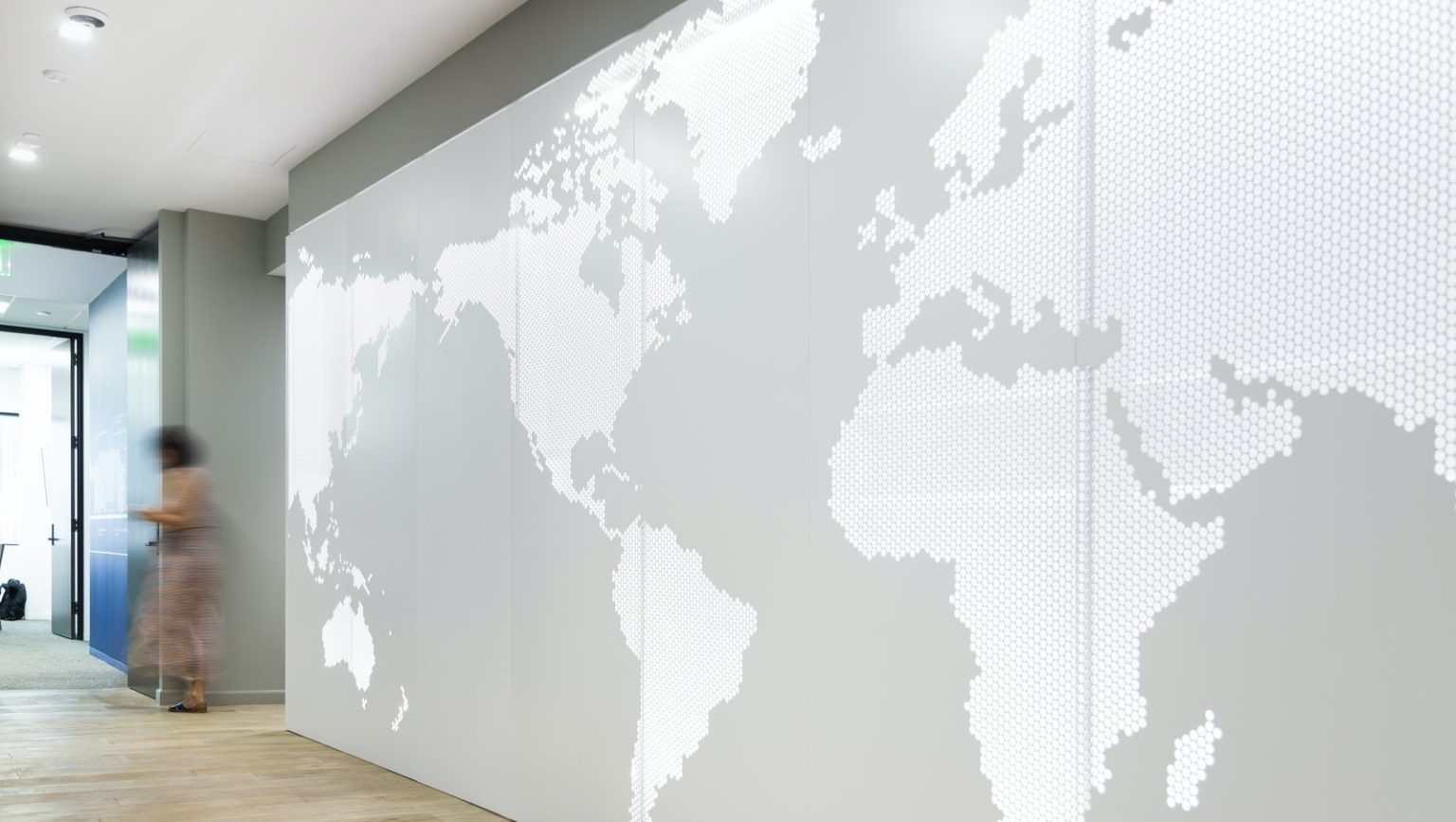Lineage Logistics by Gensler: Using ImageWall, Gensler designed a feature wall for Lineage Logistics. This gleaming lobby wall is made of painted aluminum, with depth allowance for backlighting. A clean illustration of the world is carved out on the surface of the wall, signifying the international reach of the company.