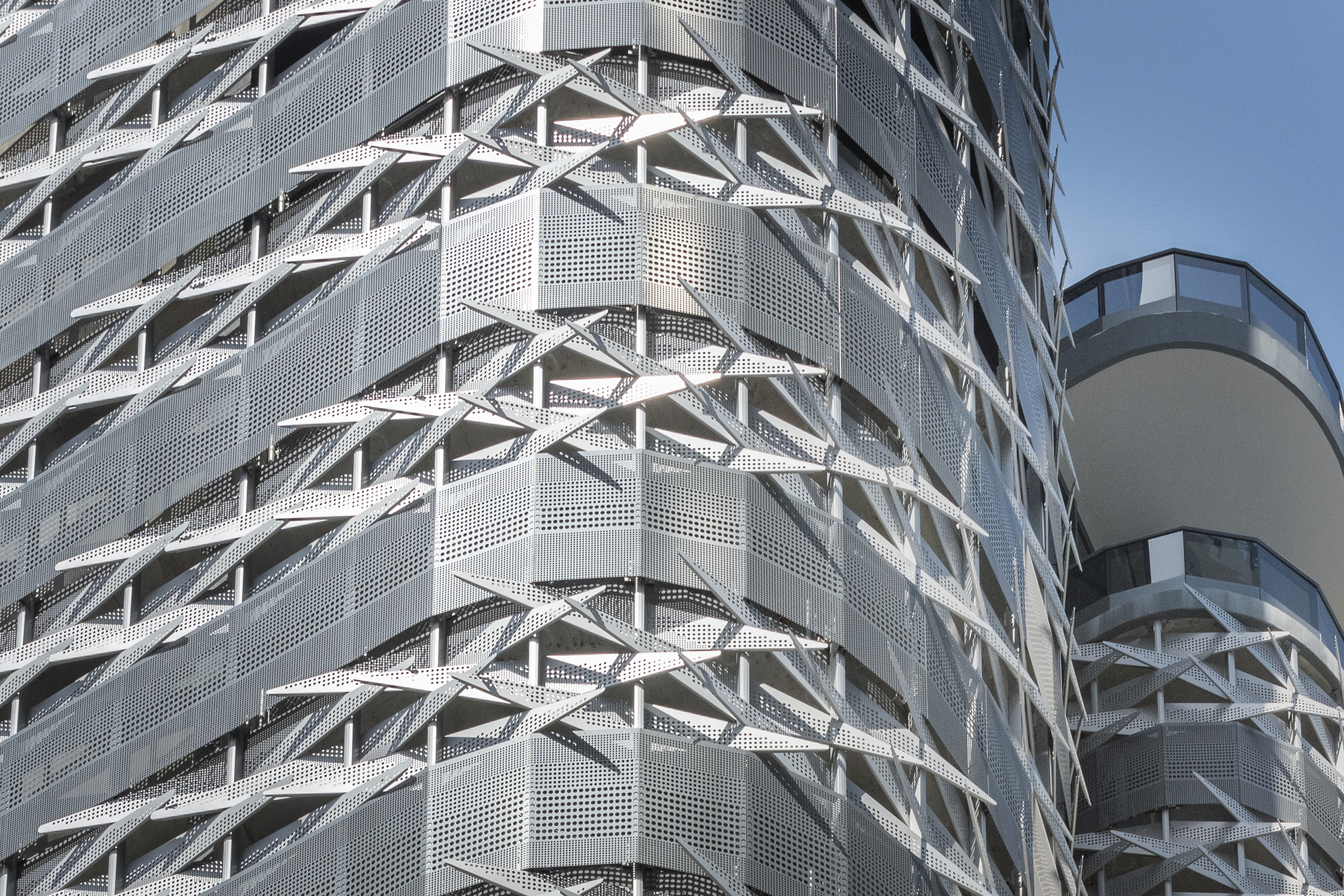 Custom perforated-metal facade for Brickell Flatiron in Miami, produced by Zahner.