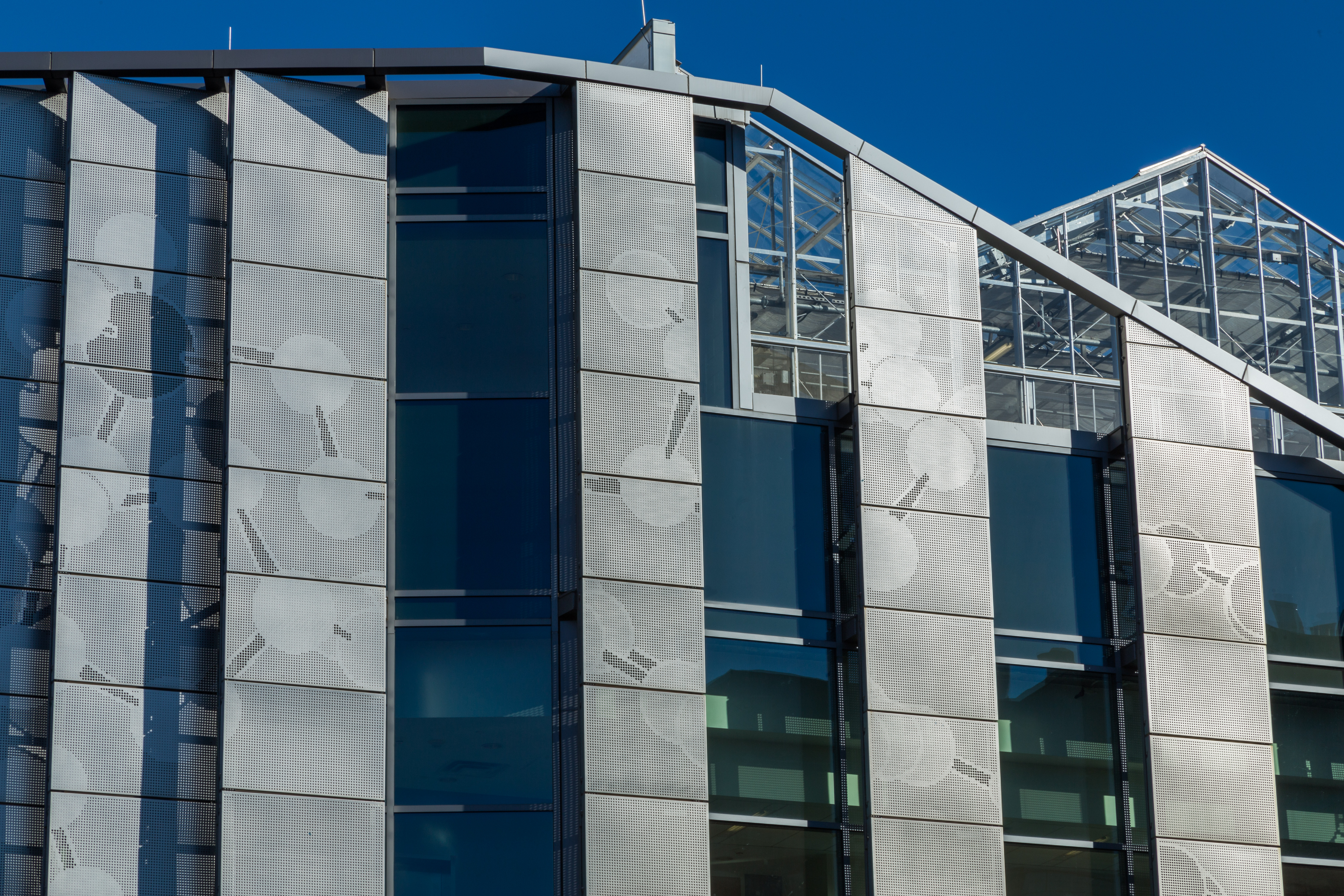George Mason University's Science and Technology building features a custom perforated facade, created using Zahner ImageWall technology.