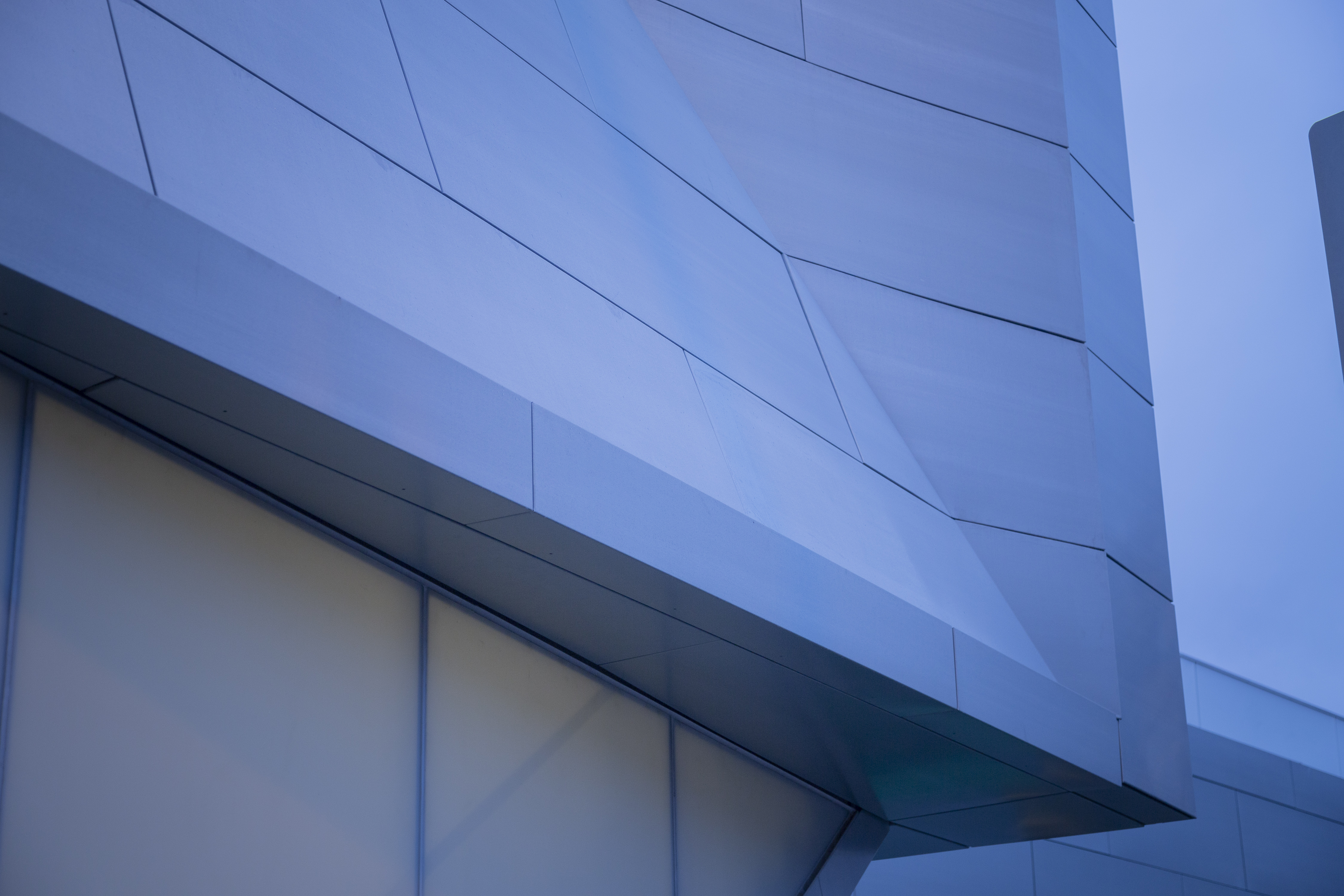 Complex surface geometry incorporated into the zinc panel system