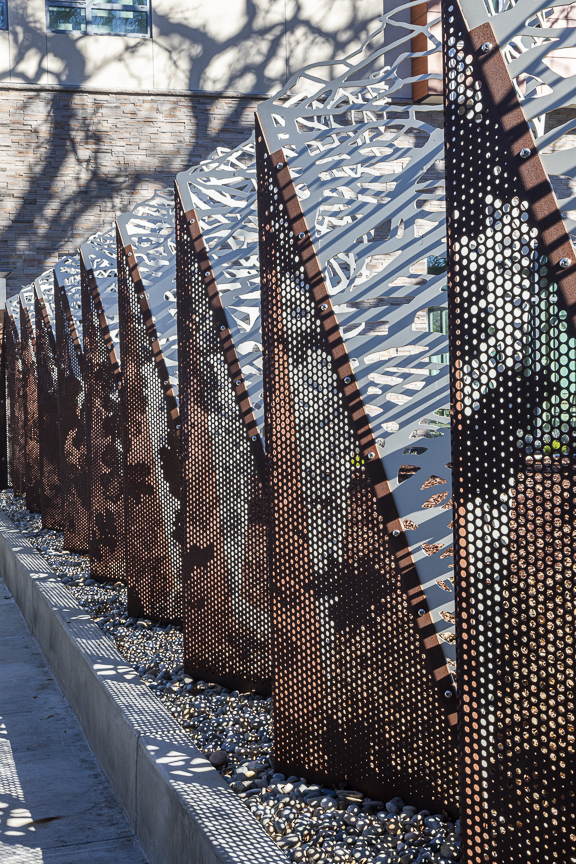 The leaves pattern on the Solanum panels was created using our ImageWall® custom-perforation technology.