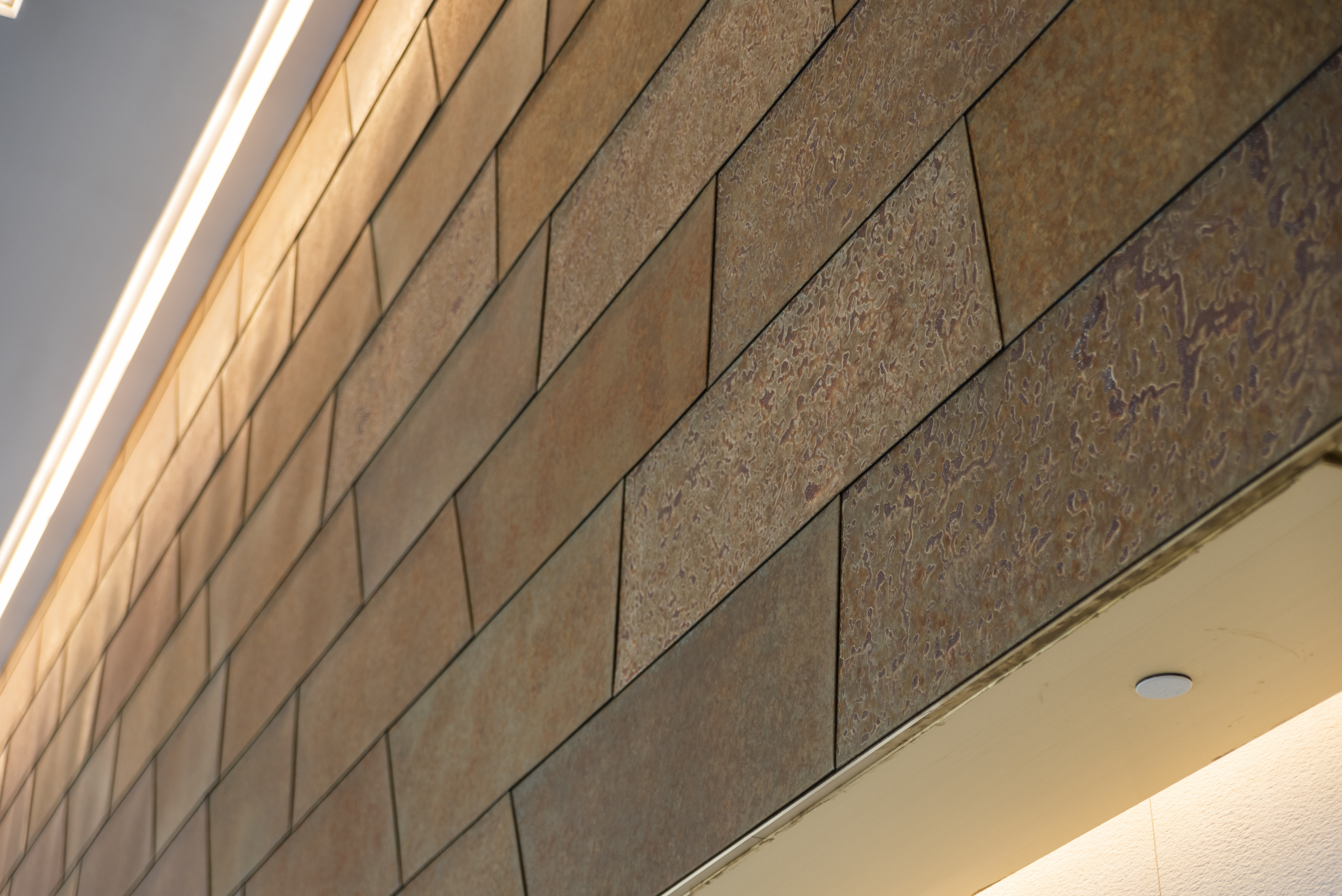 Roano Zinc panels were manufactured and installed by Zahner in the lobby of 2100 L Street.