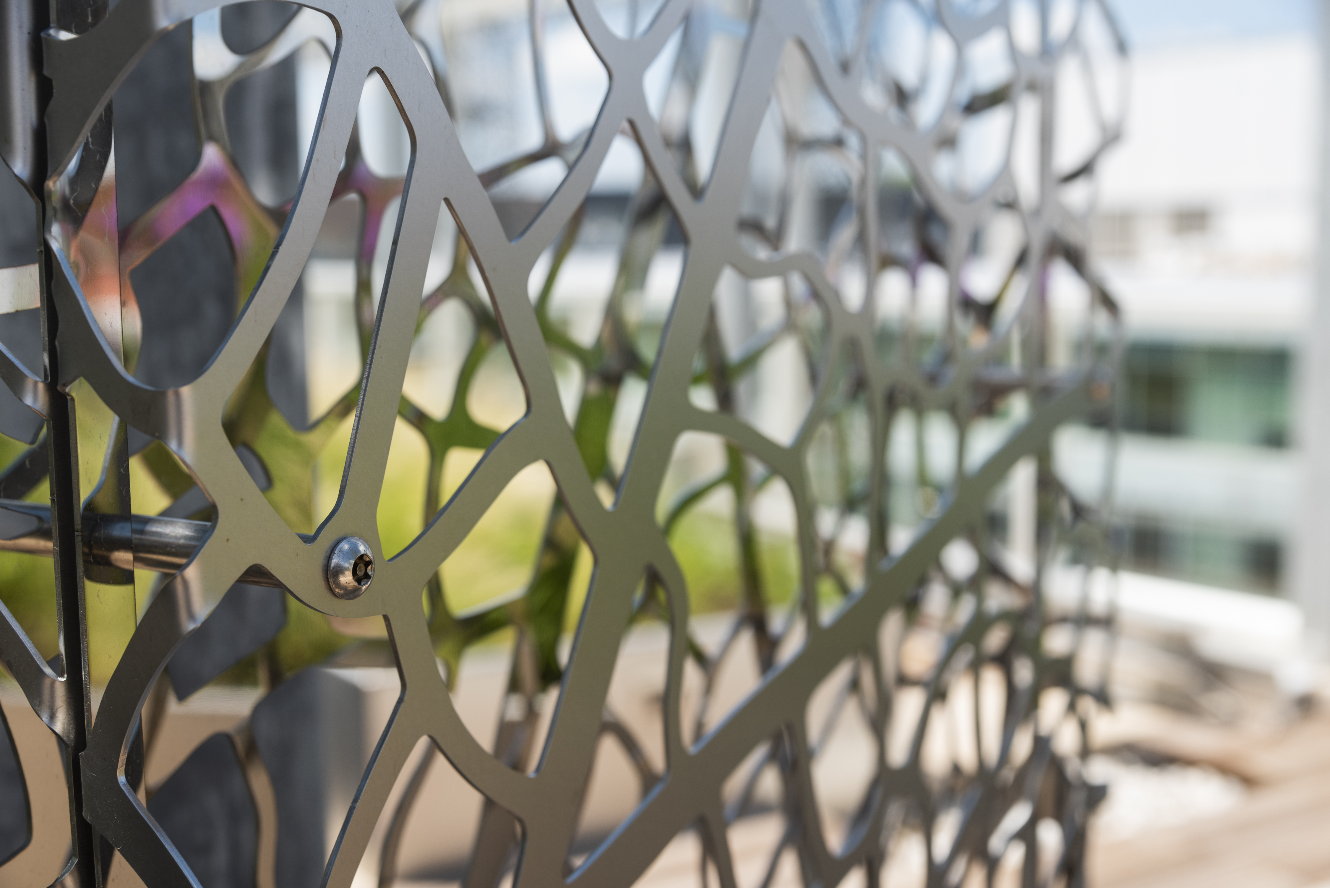 Detail of dual-sided art screen with Angel Hair polished stainless steel