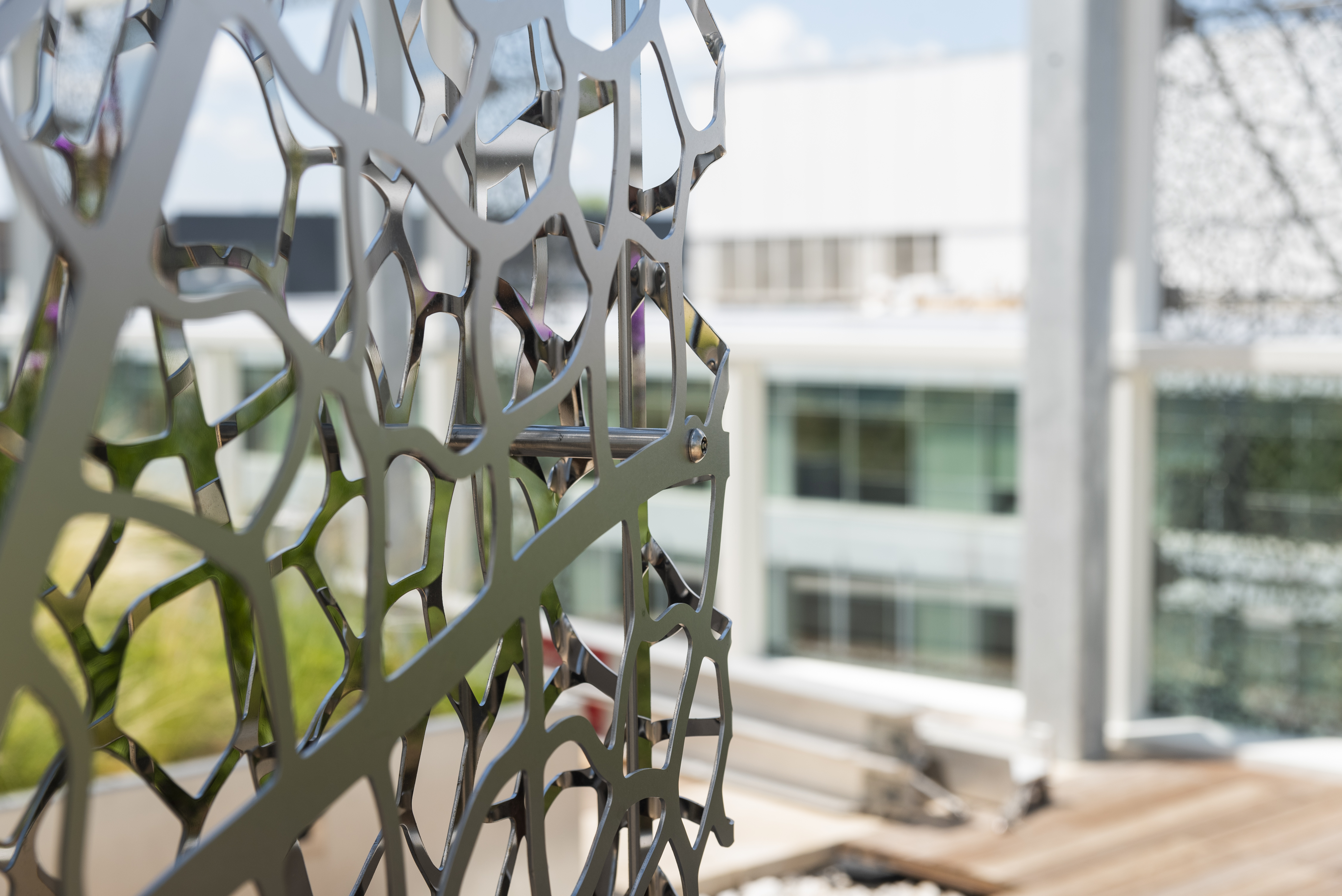 Detail of dual-sided art screen with No. 8 mirror polished stainless steel