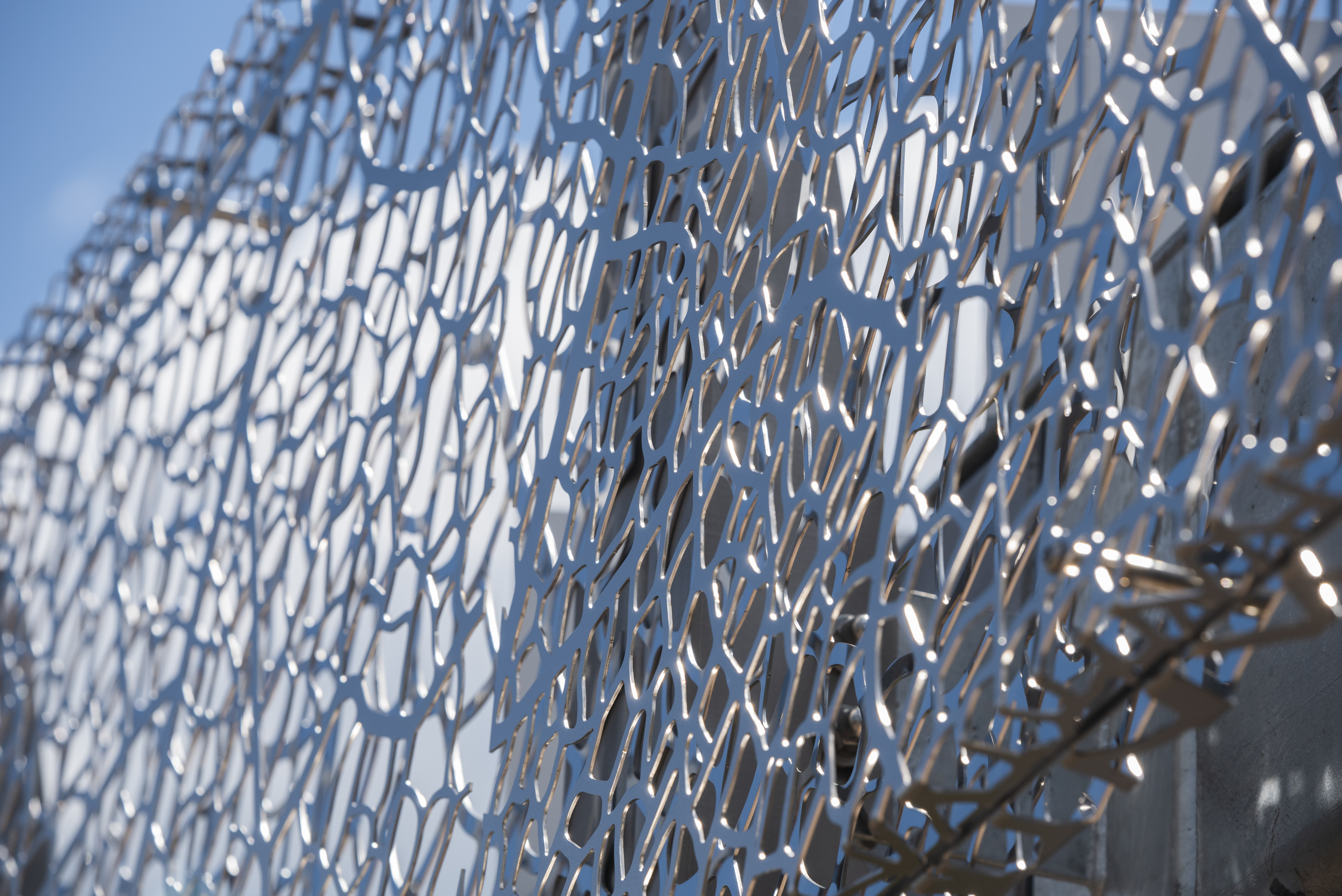 Closeup of the lazer-cut stainless steel art screen for 2100 L Street.