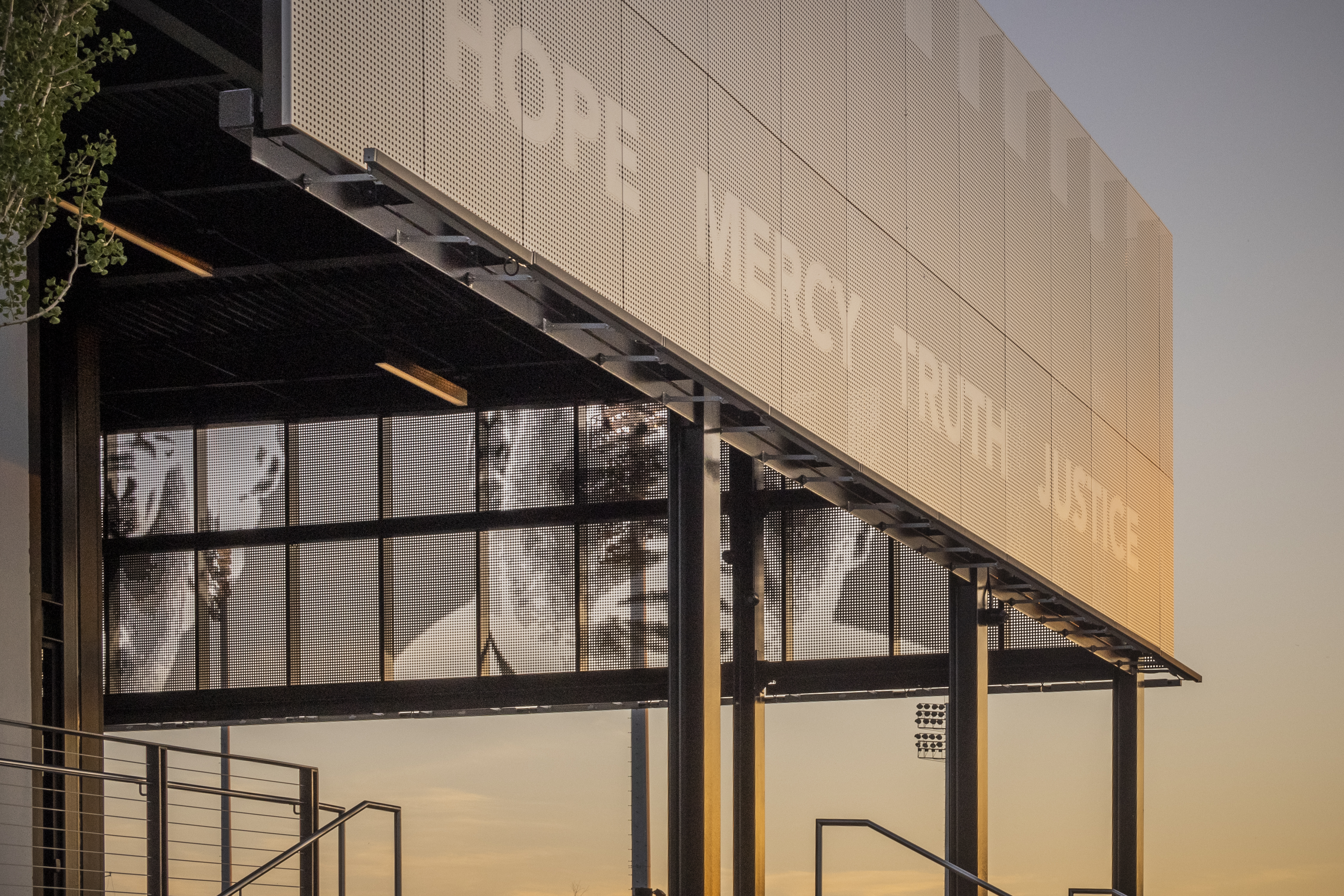 The ImageWall screen floats above the patio of the Legacy Pavilion and looks out over the park grounds.